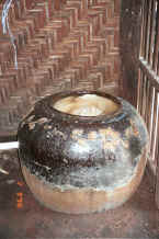 Jpeg 50K Huge jar full of sago used in the final rinsing of the dyed cotton to help stiffen and separate the threads ready for weaving - Amarapura, Shan State 9809f35.jpg