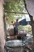 Jpeg 37K Getting water from the well for the rinsing process - Amarapura, Shan State 9809g03.jpg