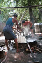 Jpeg 46K Plunging a second handful of fresh cotton hanks of thread into the dye bath - Amarapura, Shan State 9809g05.jpg