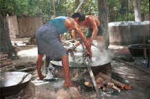 Jpeg 36K Stirring the cotton hanks around in the dye bath - Amarapura, Shan State 9809g07.jpg