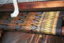 to Jpeg 48 K 9809P08 Four colour silk ikat on the loom at a weaving mill at Innbawkon (Inpawkhon) on Lake Inle, Shan State. Note the 'bow' across the width of the weft to keep the width and tension constant.