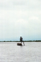 to Jpeg 57K 9809P31 Intha boatman leg-rowing on Lake Inle, Shan State.