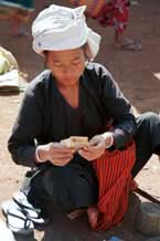 to 26K Jpeg 9809H32 Pa'O market trader counting her money at the Kalaw 5-day rotating market, Shan State.