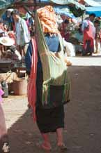 to 29K Jpeg 9809I07 Pa'O woman at Kalaw market, Shan State, with a typical Shan bag over her shoulder and a green striped one on her head carrying her supplies