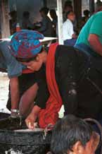 to 24K Jpeg 9809N16 Pa'O woman checking the quality of the rice in Nampan 5-day rotating market, Lake Inle, Shan State