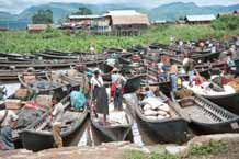 to 46K Jpeg 9809O02 Boats drawn up at the water's edge for the 5 - day rotating market at Nampan on Lake Inle, Shan State.