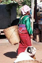 to 72K Jpeg Silver Palaung woman with a bask on her back striding through the market in Kalaw, Shan State
