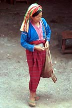to Jpeg 72K Silver Palaung woman coming away from the market in Kalaw. Note her traditional woven bag for produce