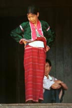 to 44K Jpeg A Silver Palaung woman in traditional dress on the porch outside a house in Pein Ne Bin village, near Kalaw, southwestern Shan State. This photograph shows a good example of the traditional costume although she does not appear to be wearing any bamboo or rattan hoops.