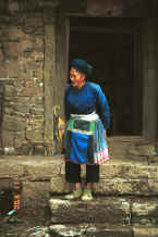 Jpeg 42K Miao woman coming our of her stone house - Chang Tion village, Cheng Guan township, Puding county, Guizhou province 0010w03.jpg