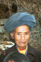 Jpeg 38K Miao woman - although she is wearing a manufactured coat her turban looks to be hand woven and hand dyed with indigo - Chang Tion village, Cheng Guan township, Puding county, Guizhou province 0010w32.jpg