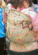 Jpeg 44K Miao baby carrier in the Side Comb Miao style - Close-up of couched embroidery baby carrier - Chang Tion village, Cheng Guan township, Puding county, Guizhou province 0010w37.jpg