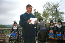 Jpeg 31K The village Secretary reading out a welcome and thanks to the Black Miao girls for dancing for us -  - Dai Lo village, Shi Zi township, Ping Ba county, Guizhou county 0010z19.jpg