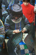 Jpeg 37K Black Miao girl demonstrating her embroidery on a piece for a woman's jacket - Dai Lo village, Shi Zi township, Ping Ba county, Guizhou county 0010z27.jpg