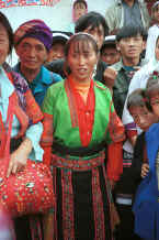 Jpeg 36K Red Hat Miao woman modelling a jacket which I had just bought from her - De Wo market, De Wo township, Longlin county, Guangxi province. 0010g06.jpg