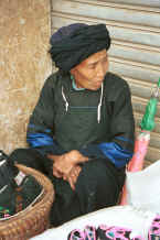 Jpeg 30K Selling handmade shoes at De Wo market.  Possibly a Bouyei old lady.  De Wo township, Longlin county, Guangxi province 0010g22.jpg