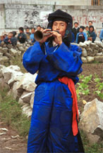 to Jpeg 51K 0110D15  Trumpeter blowing his welcome to Gan He village, Ya Rong township, Huishui county, Guizhou province, south-west China. Note the complex weaving of the ends of his head-cloth. The people living in this village are known as Qing Miao. There has been much intermarriage between Miao and Bouyei which is evident from the costume of the women.to Jpeg 51K 0110D15  Trumpeter blowing his welcome to Gan He village, Ya Rong township, Huishui county, Guizhou province, south-west China. The people living in this village are known as Qing Miao. There has been much intermarriage between Miao and Bouyei which is evident from the costume of the women.