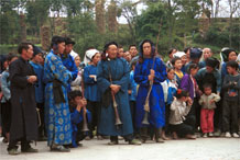 to Jpeg 53K  0110D37 Musicians resting in Gan He village, Ya Rong township, Huishui county, Guizhou province, south-west China. The people living in this village are known as Qing Miao.