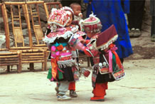 to Jpeg 109K Iron beating Miao festival costume in miniature worn by little girls dancing in Gao Zhai village, Bai Jin township, Huishui county, Guizhou province 0110C07
