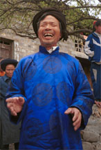 to Jpeg 139K Head man of Gao Zhai village, Bai Jin township, Huishui county, Guizhou province welcoming us to the village having put on a splendid silk coat over his working clothes 0110C12
