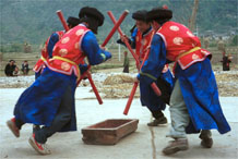 to Jpeg 78K Miao men dancing and simulating stirring sticky rice in Gao Zhai village, Bai Jin township, Huishui county, Guizhou province against the backdrop of the farm land in the narrow valley 0110C26