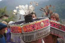 to Jpeg 126K Excessively decorated woman's head dress in the fashion of the dancing troupes, Gao Zhai village, Bai Jin township, Huishui county, Guizhou province 0110D05