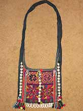 to 43K Jpeg  Hani embroidered and trimmed bag, Menghai  county, Yunnan province, southwest China