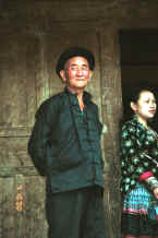 Jpeg 33K Side comb Miao man and woman outside the door to their home - Long Dong village, De Wo township, Longlin country, Guangxi province 0010e05.jpg