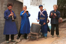 to Jpeg 75K Welcoming musicians at the entrance to Lou Jia Zhuang village, Anshun city, Guizhou province 0110A34