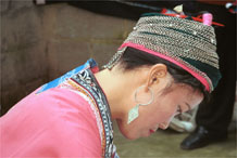 to Jpeg 75K Miao woman concentrating on her wax resist. Note her traditional hair style (and a la dio (wax knife) tucked in her hair near the circular (red) comb. Lou Jia Zhuang village, Anshun city, Guizhou province 0110B21