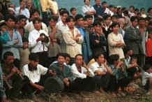 Jpeg 39K Crowd of White Miao men, some playing instruments, Ma Wo village, Zhe Lang township, Longlin county, Guangxi province 0010j25.jpg