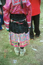 Jpeg 38K Back view of a White Miao woman showing her embroidered and beaded ties  - Ma Wo village, Zhe Lang township, Longlin county, Guangxi province 0010k08.jpg