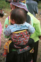 Jpedg 36K White Miao baby held in an embroidered  baby carrier, Ma Wo village, Zhe Lang township, Longlin county, Guangxi province 0010k09.jpg