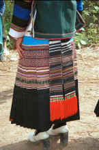 Jpeg 35K Back view of a Side Comb Miao girl's festival finery showing the hand woven ties of the apron - Pao Ma Cheng village, Teng Jiao township, Xingren country, Guizhou province 0010n12.jpg