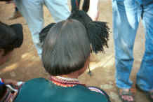 Jpeg 30K Side Comb Miao - back view of unmarried girl's hair dressed with wool - Pao Ma Cheng village, Teng Jiao township, Xingren country, Guizhou province 0010n31.jpg