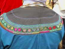 to Jpeg 57K Detail of back of woman's festival jacket in Songtao Miao Autonomous County, Tongren Prefecture, Eastern Guizhou Province, 5 February, 2004.