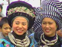 to 57K Jpeg Miao girls in woven turbans and heavy silver jewlry at a festival in a village in Songtao Miao Autonomous County, Tongren Prefecture, eastern Guizhou Province.