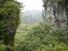 to 45K Jpeg Looking through the karst limestone cliffs down into a village in Songtao Miao Autonomous County, Tongren Prefecture, eastern Guizhou Province.