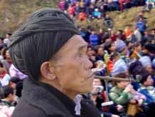 to Jpeg 37K An old man smoking his pipe at a festival in a Miao village in Songtao Miao Autonomous County, Tongren Prefecture, eastern Guizhou Province.