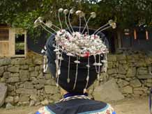 to Jpeg 47K Back view of the silver decorations on the headdress of a Miao girl at a festival in a village in Songtao Miao Autonomous County, Tongren Prefecture, eastern Guizhou Province.