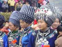to Jpeg 45K A group of Miao girls in their festival finery including the striking woven turbans 6 -10 metres in length in a village in Songtao Miao Autonomous County, Tongren Prefecture, eastern Guizhou Province.