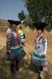to Jpeg 64K White Miao girls in festival dress at the White Miao Dance Flower festival near Dafang in April 2007
