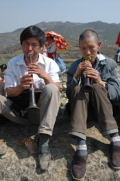 to Jpeg 66K White Miao men playing suona at the Dance Flower festival near Dafang in April 2007