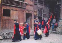 to Jpeg 47K e19e 25 February 2004, the fourth day of the festival, in Langde village, Guizhou province, On this day, the ceremony was to take the spirit of the mountain dragon inside each home to live there so the family would enjoy good fortune in the future.