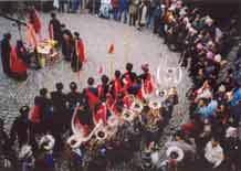 to Jpeg 53K e23e 29 February 2004, the fourth day of the fertility festival. The villagers started to dance to lusheng and bronze drum and a magical tree was planted in the centre of the ground. Men and women in festival dress danced together, the girls wearing plenty of silver. All the girls who had married into other villages or places also came back for the dancing. Everyone from the village joined in the dancing, whether rich or poor, male or female, young or old.