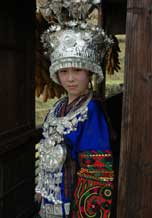 to 68K Jpg image Tony's bride, Huyan, although she is Han and not Miao, is wearing the traditional Long Skirt Miao festival clothes of Tony's village, Langde for the wedding.