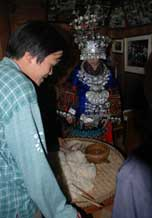 to 59K Jpg image Inside the groom's house the food to be offered by the bride to the ancestors of the groom's family.