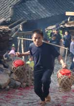 to 69K Jpg image The rice wine given by Tony's older sister being carried up to the village