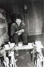 to Jpeg 46K A Miao shamna carrying out a ceremony