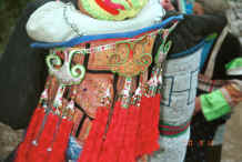 Jpeg 41K Close up of Side Comb Miao Baby carrier ornamentation - Xian Ma village, Hou Chang township, Puding county, Guizhou province 0010y20.jpg